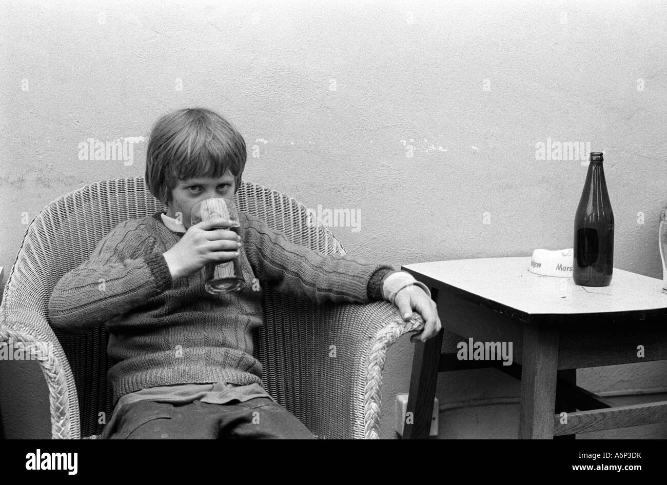 Young boy underage drinking. Pub public house in Bellerby Yorkshire  England 1973 - Stock Image