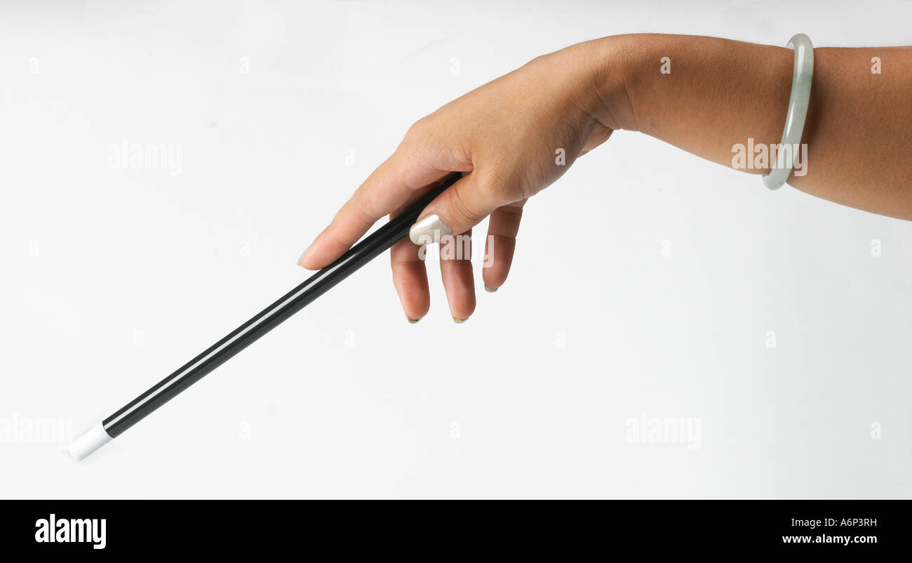magic wand casting a spell - Stock Image