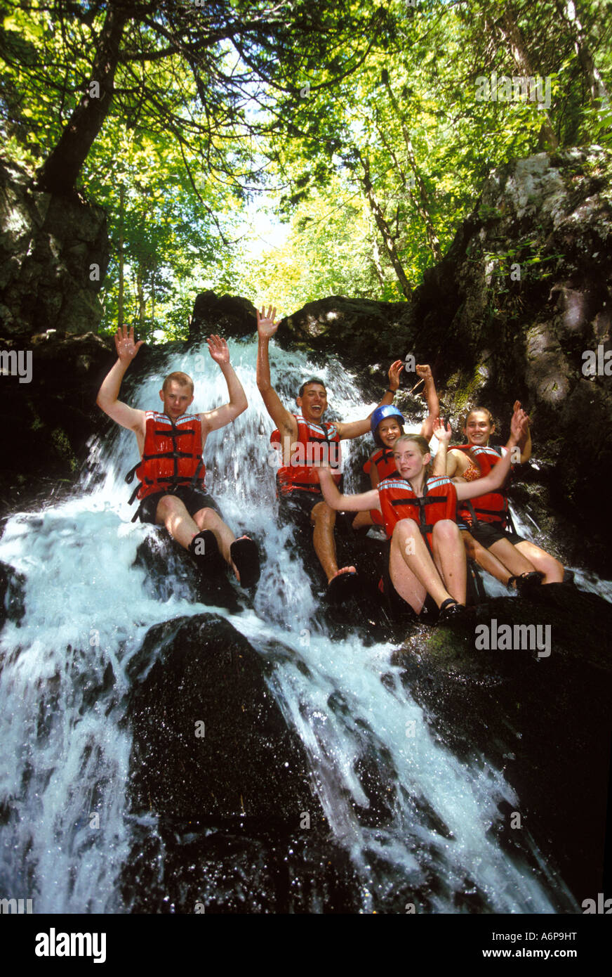 Group Young Kids Having Fun Canyoning Or Sliding Down A Waterfall In The Countryside