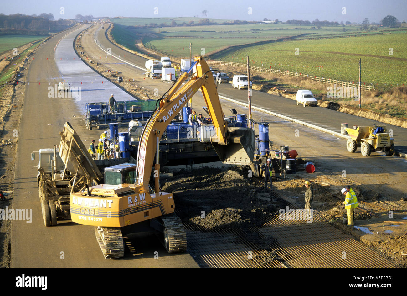 road construction machinery and workers building a1 m1 link road