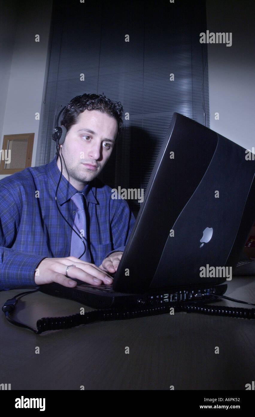 Surveillance officer listens in on conversation UK - Stock Image