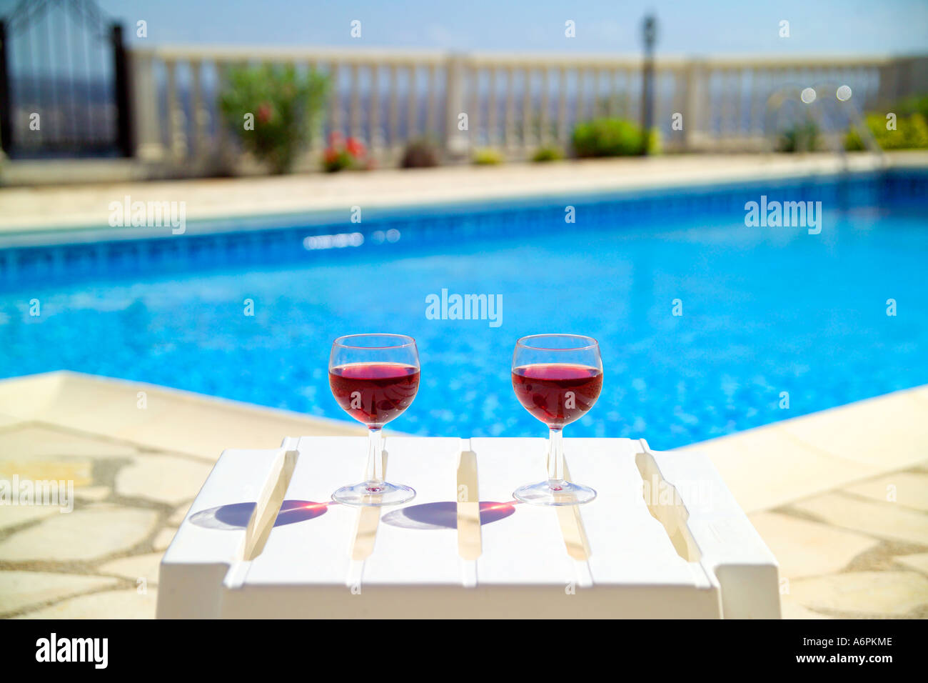 Two Red Wine Glasses Next To Swimming Pool In Cyprus With View Into Stock Photo 6644877 Alamy