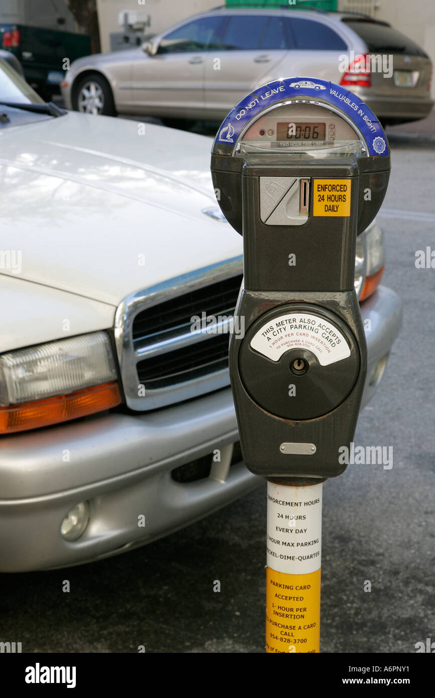 Car parked at parking meter with violation ticket city