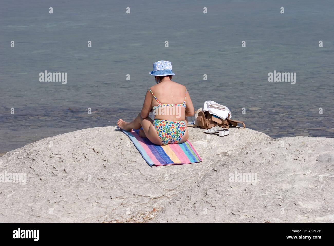 Lady Sunbather Sirmione Lake Garda Lombardy Italy - Stock Image