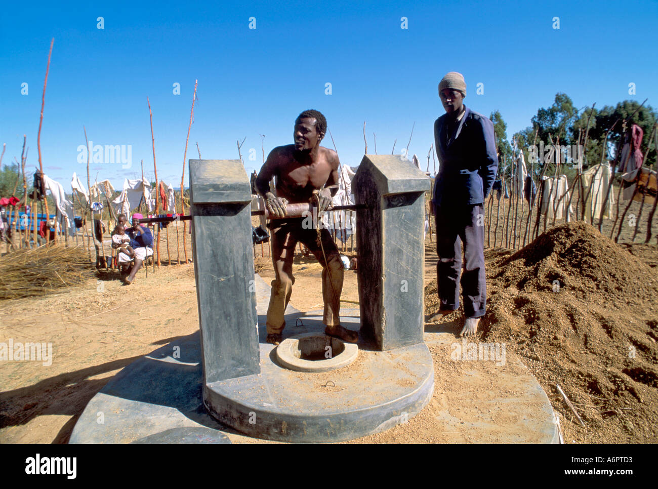 Deepening a village well due to drought. Zimbabwe - Stock Image