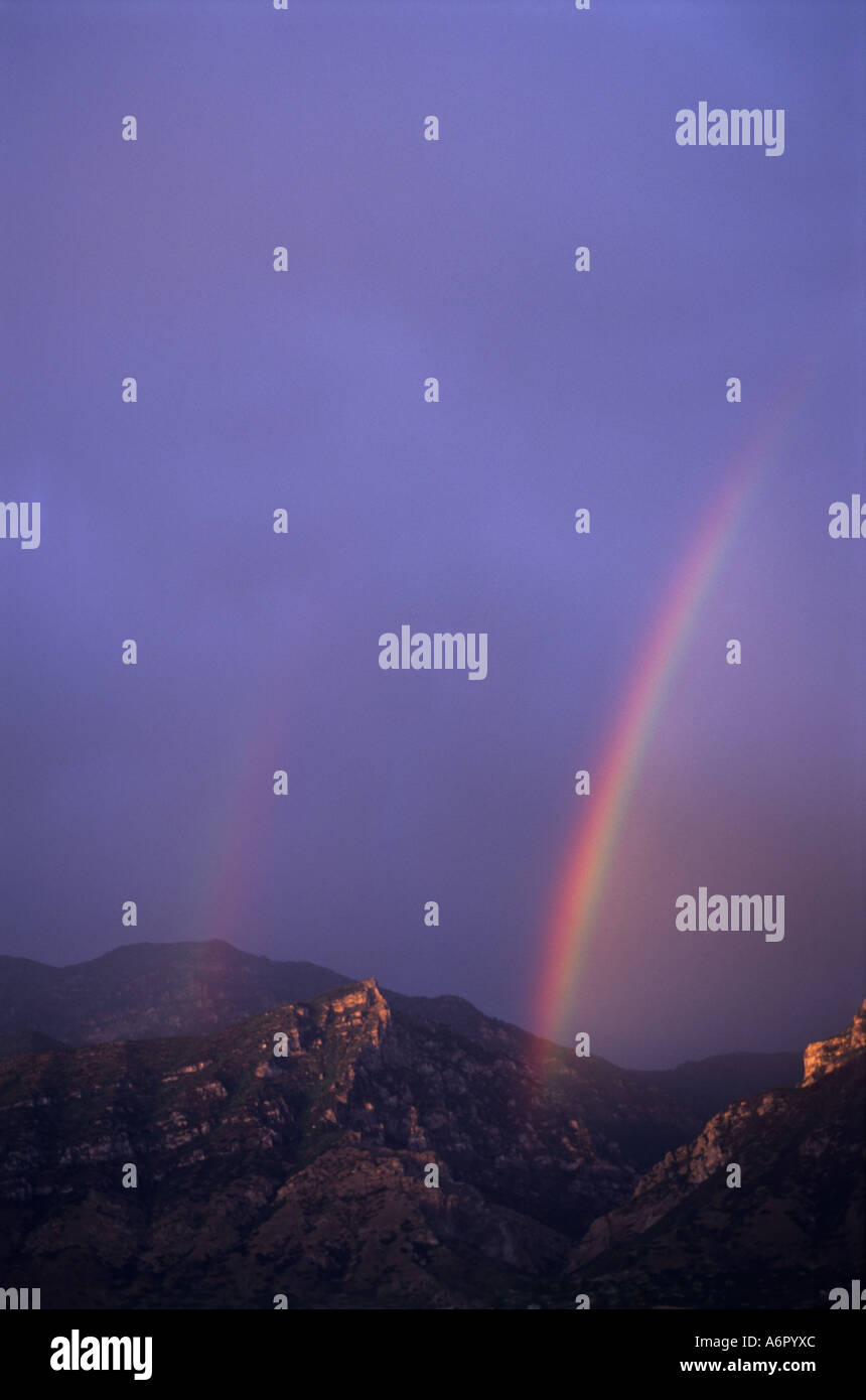 rainbow storm mountains - Stock Image