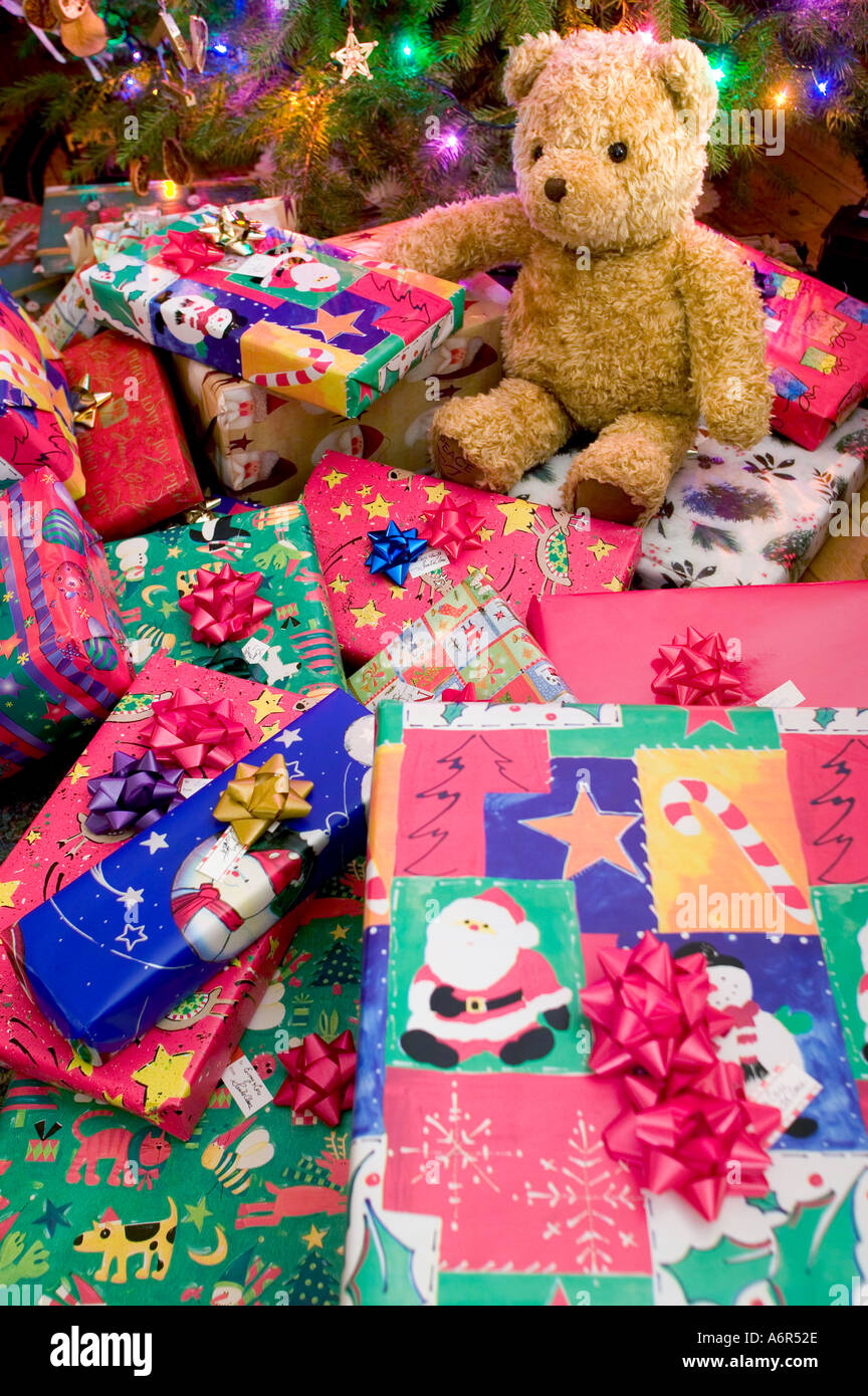 Holiday gifts wrapped and placed beneath the Christmas tree to be ...