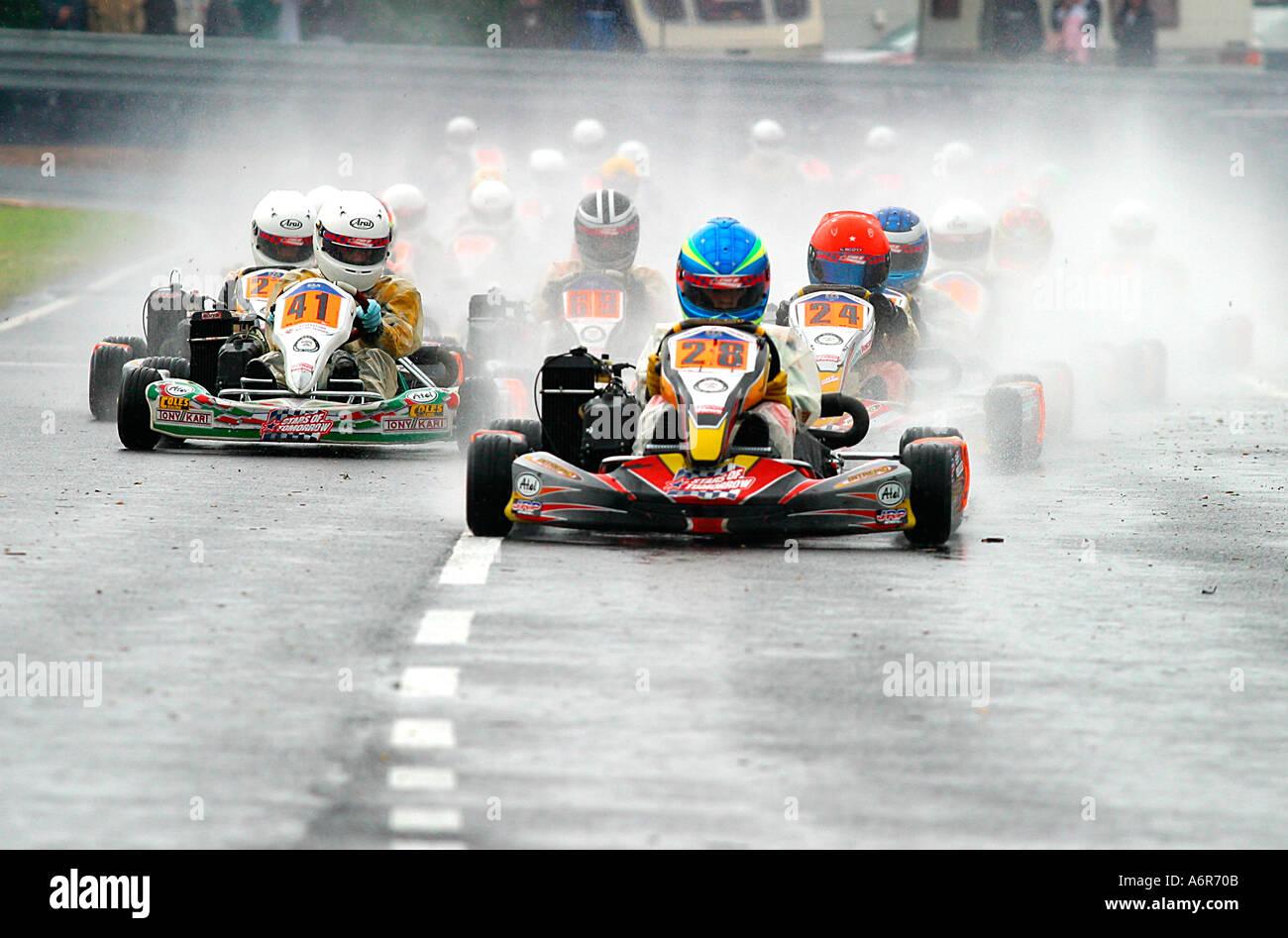 Mini Max Go Kart racing on wet race track Stock Photo: 2160394 - Alamy