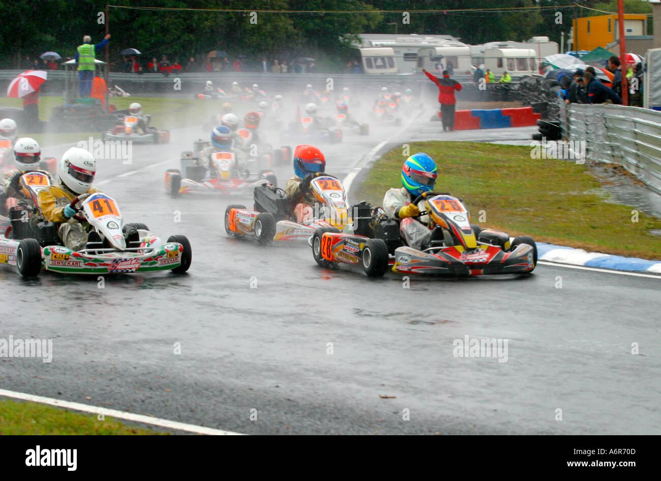 Mini Max Go Kart racing on wet race track Stock Photo: 2160396 - Alamy