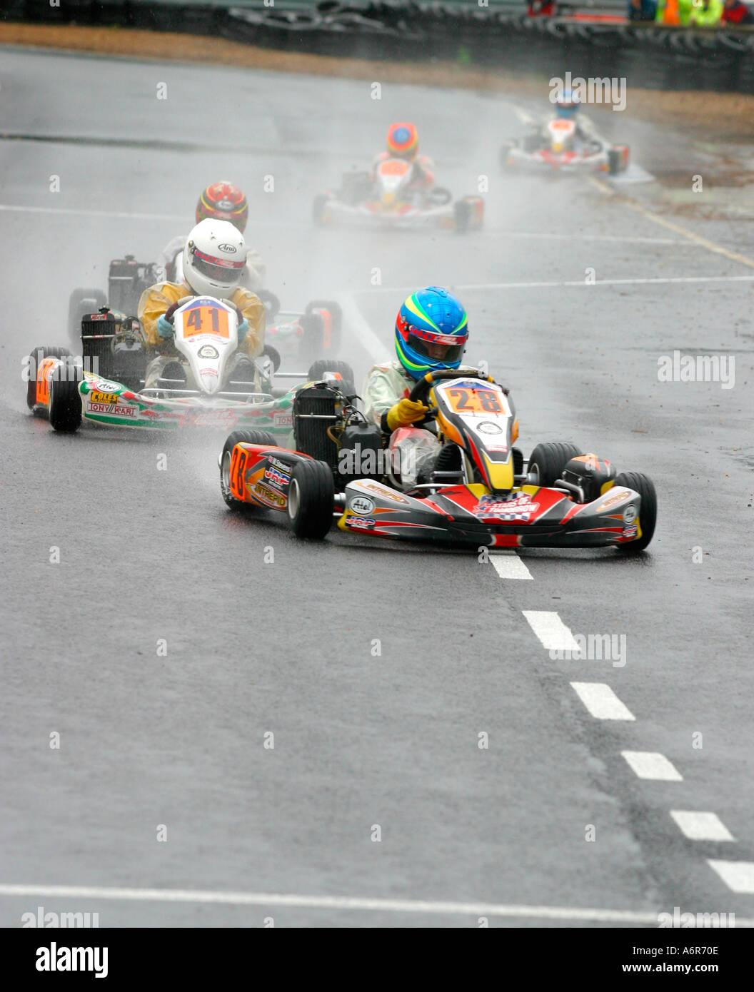 Mini Max Go Kart racing on wet race track Stock Photo: 2160397 - Alamy