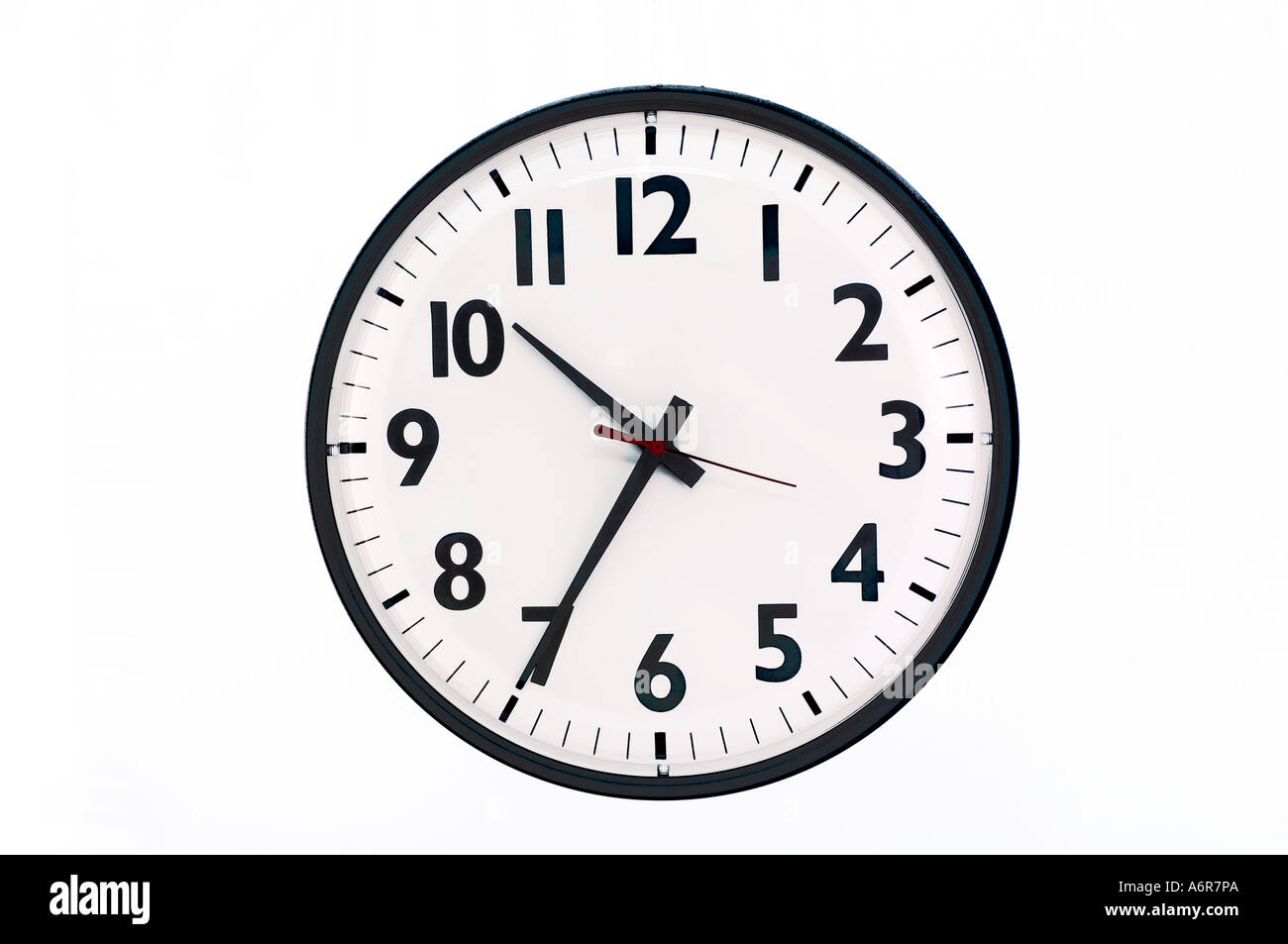 closeup of wall clock in office - Stock Image