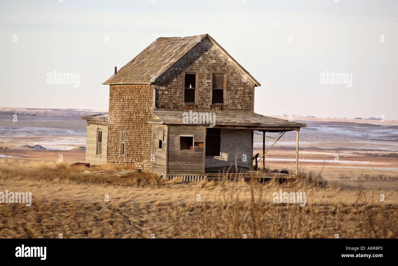 An Old Abandoned Farm House With Cedar Siding In Scenic