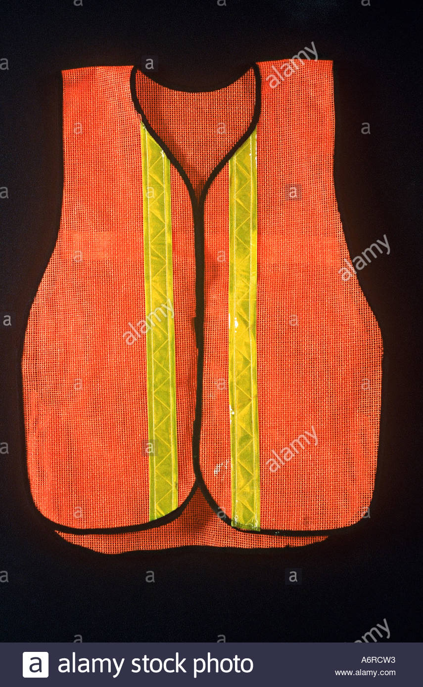 Traffic worker s reflective vest against black surface - Stock Image