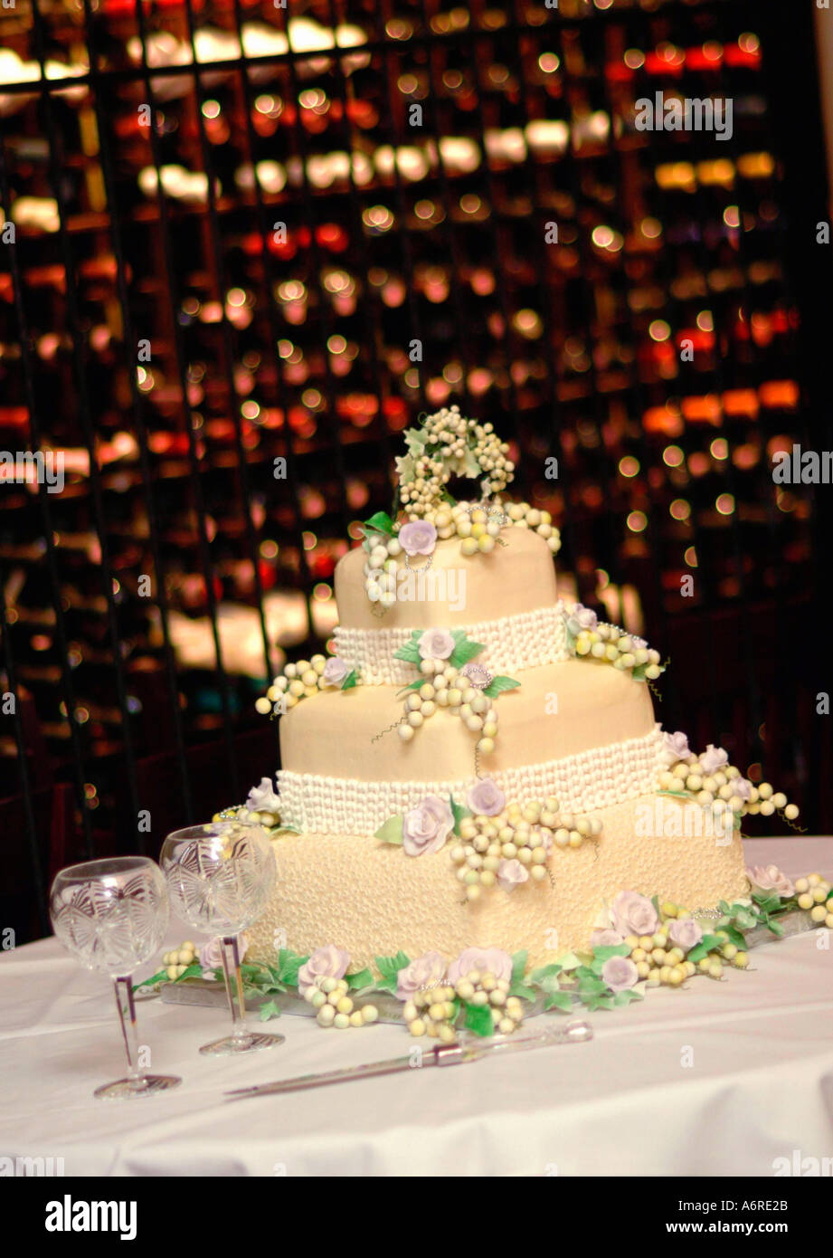 Wedding day element cream wedding cake on table in front of wine ...