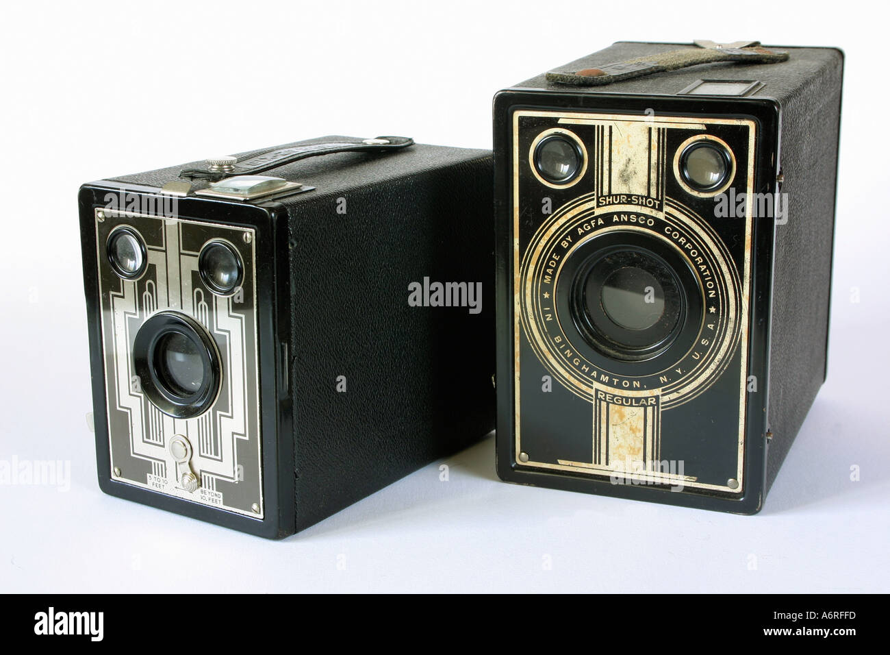 Two vintage antique box brownie cameras against white studio background - Stock Image