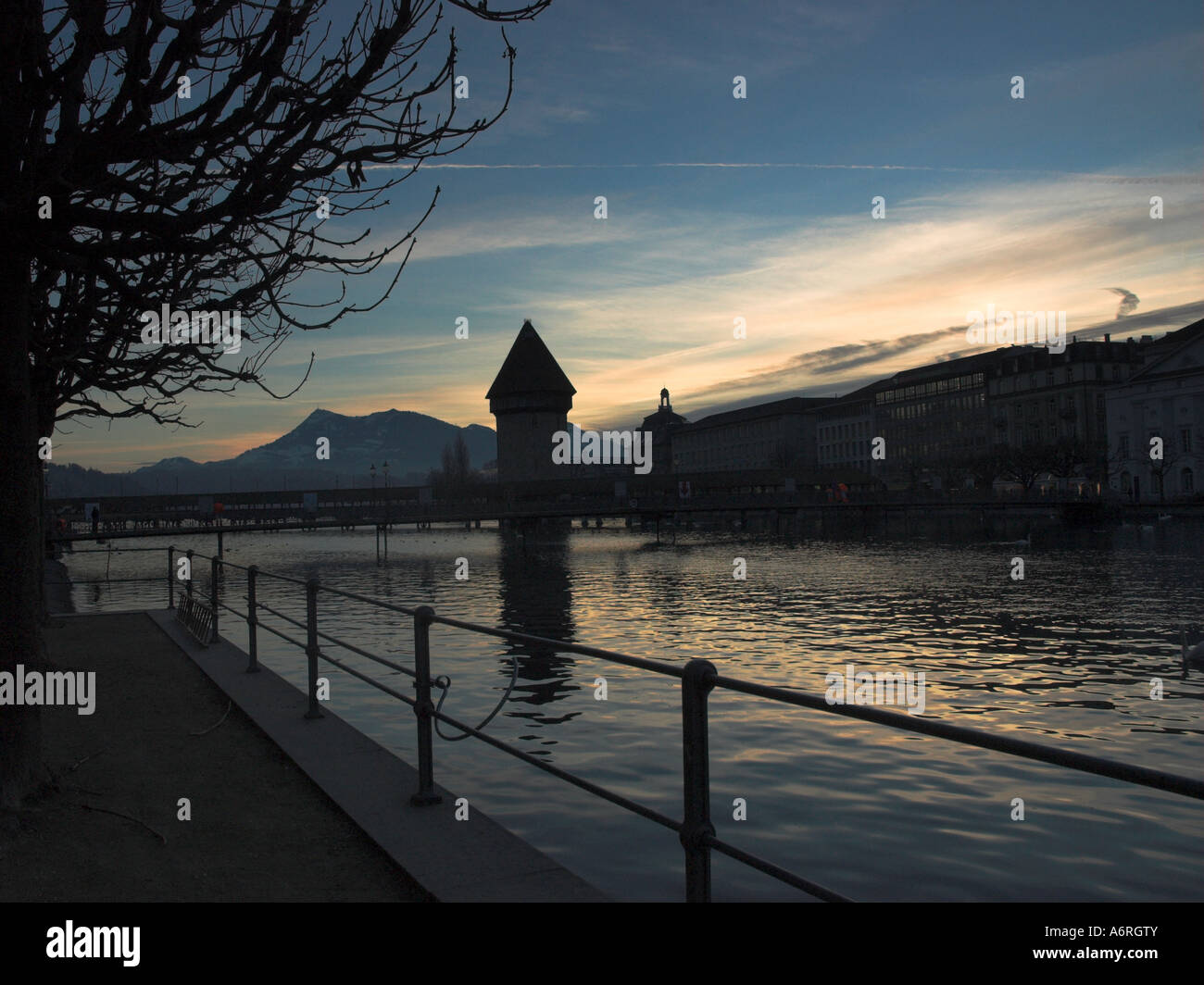 chapell bridge and watertower in Lucerne at sunrise - Stock Image