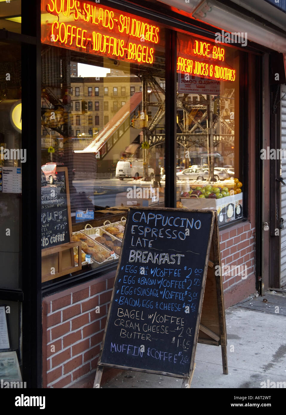black chalk board sales sign outside a coffee shop or deli on the upper west side of manhattan in the morning with neon sign