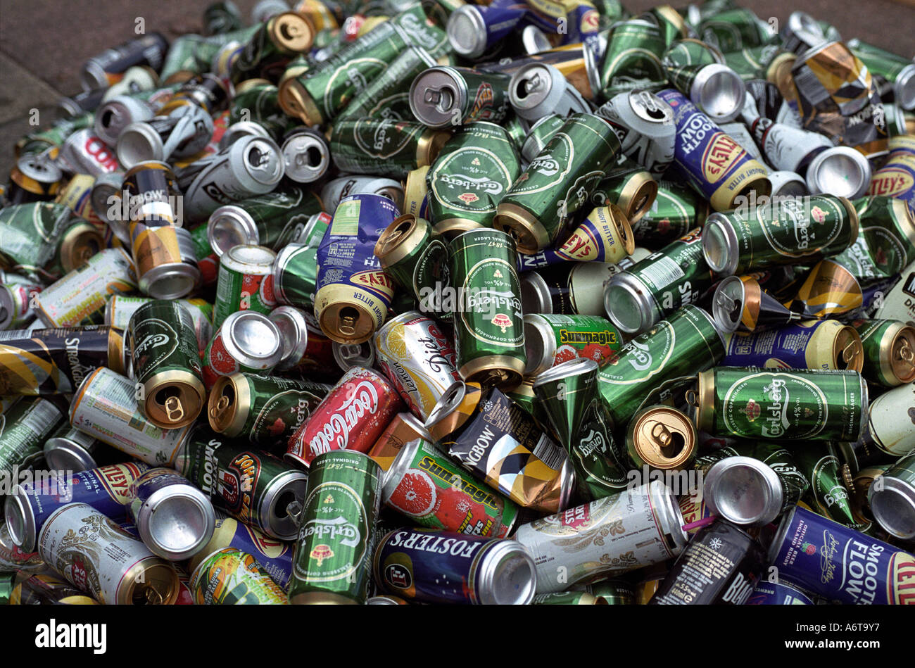 pile of empty drinking can waiting to be sorted for recycling - Stock Image