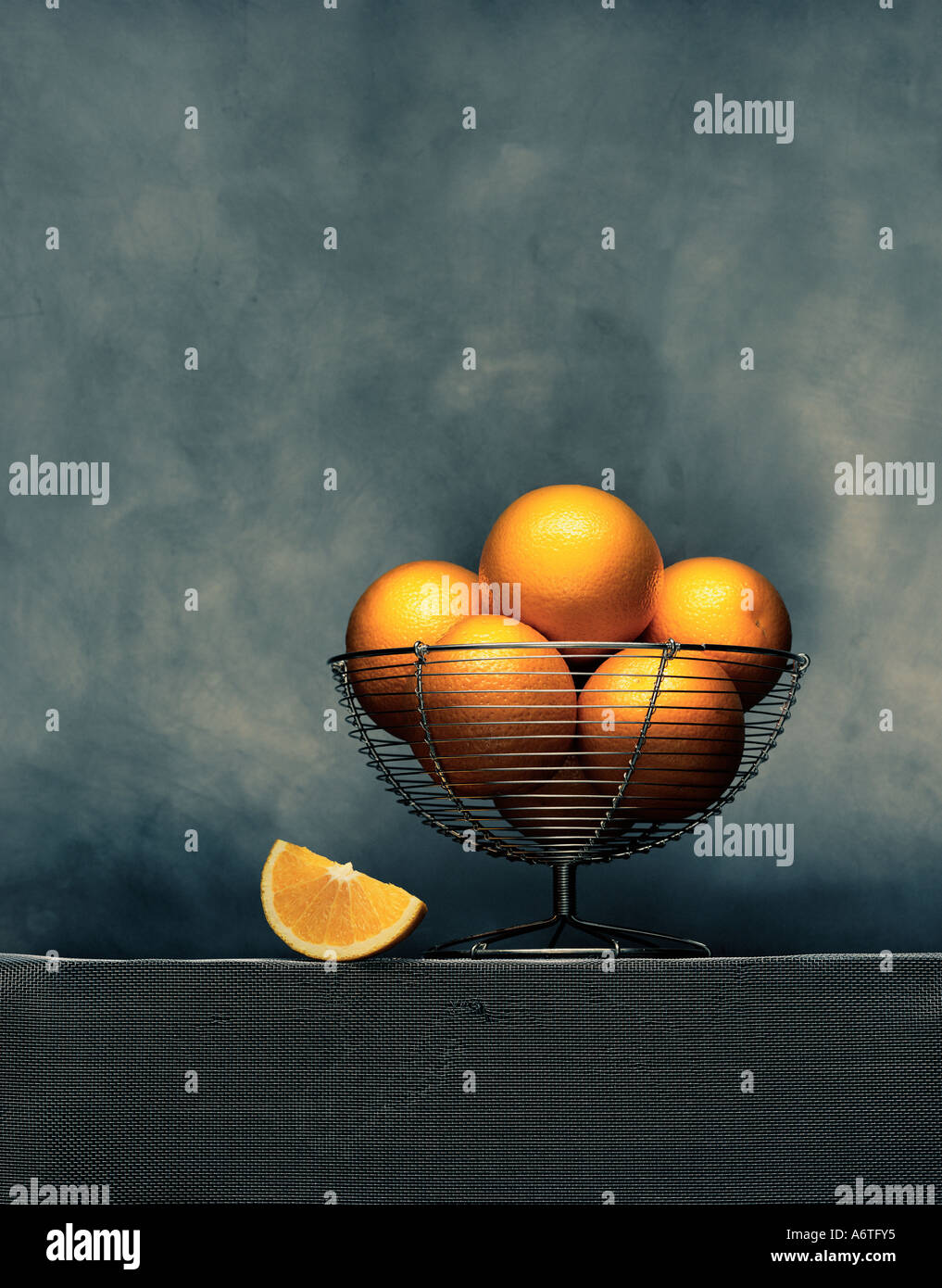 A bowl of oranges - Stock Image