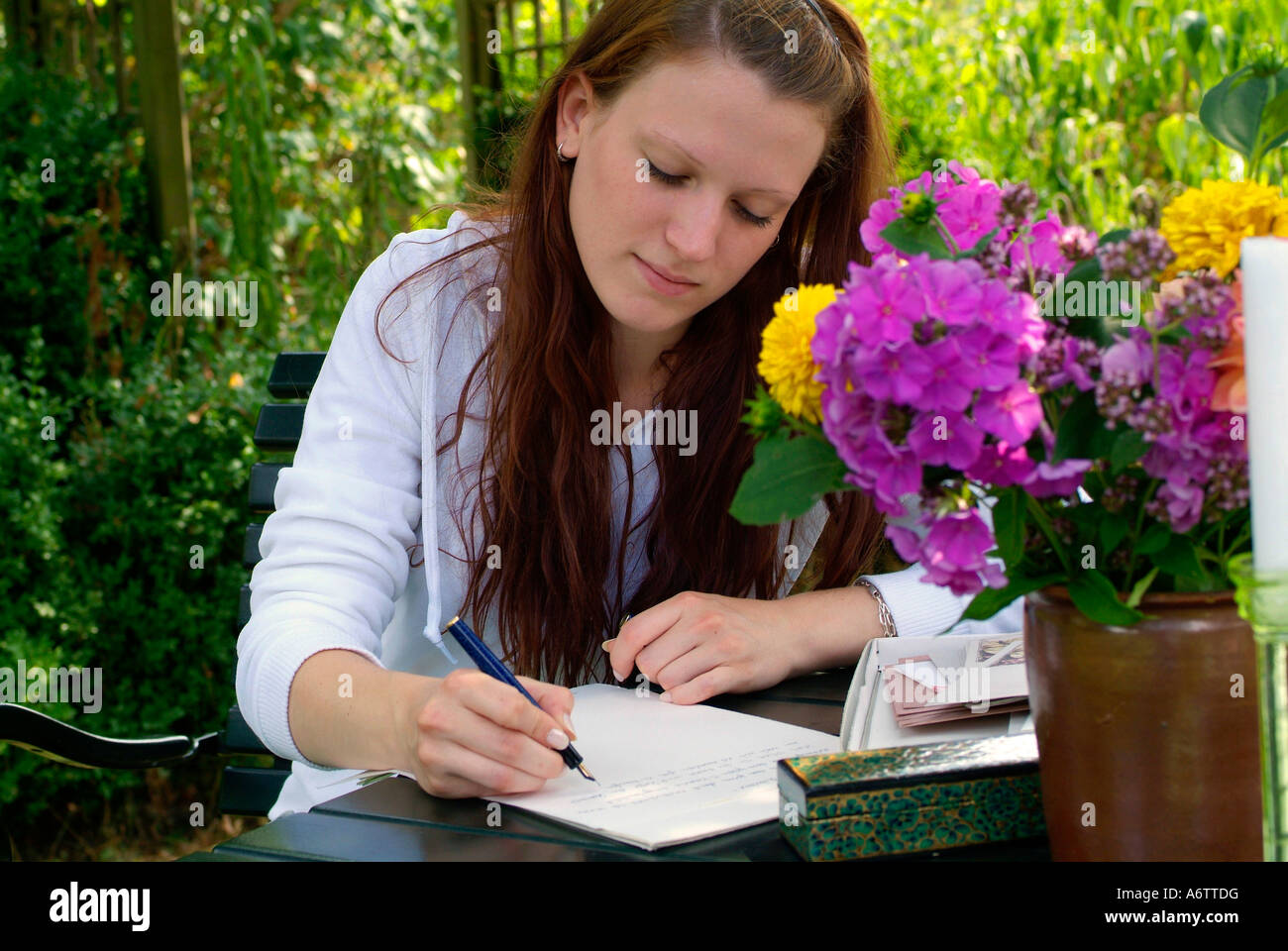 Young woman writing a letter with a fountain pen Stock Photo ...