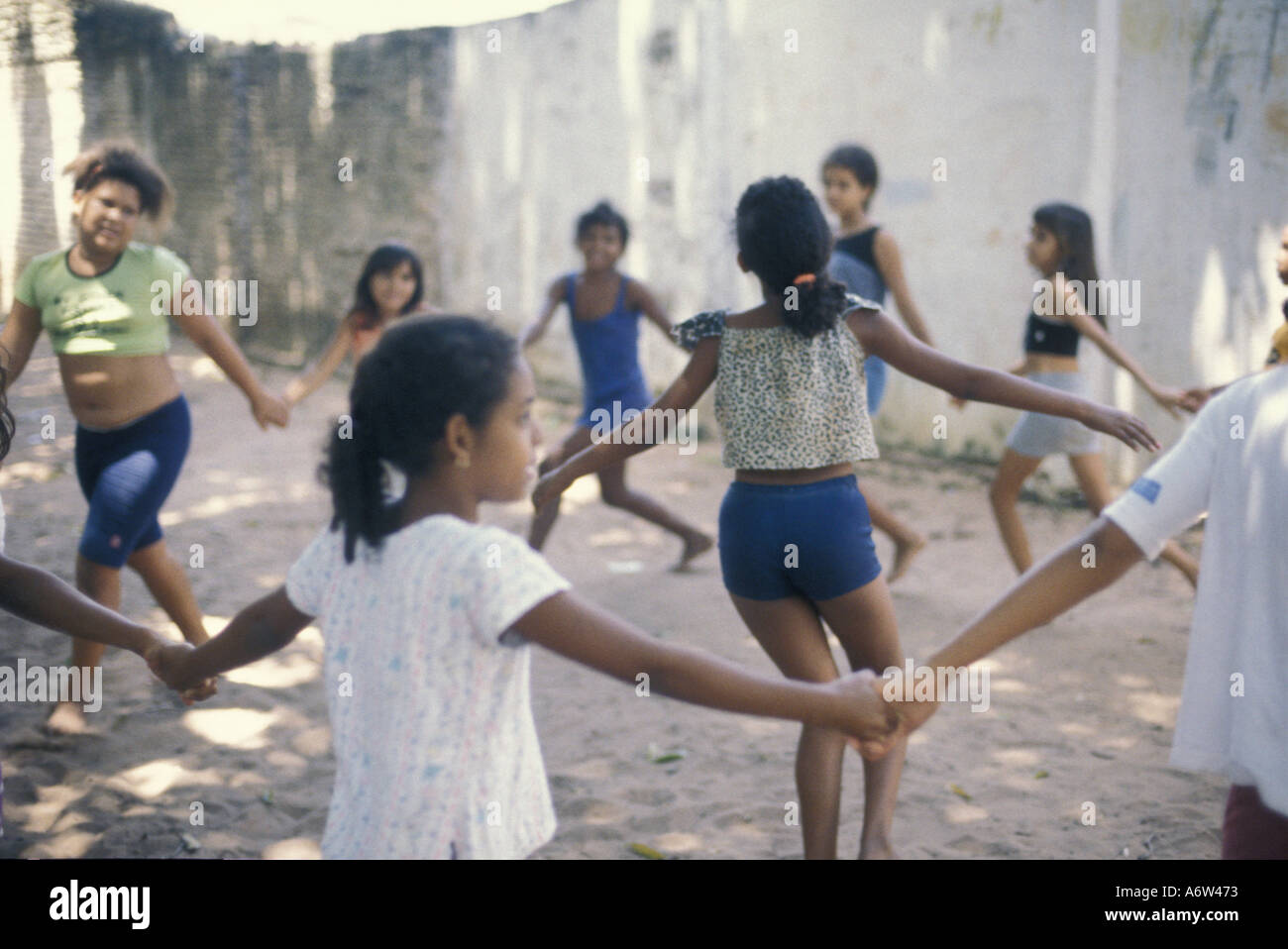 Multi-ethnic group of poor children plays ring-around-a-rosy, Natal, Rio Grande do Norte State, northeastern Brazil. - Stock Image
