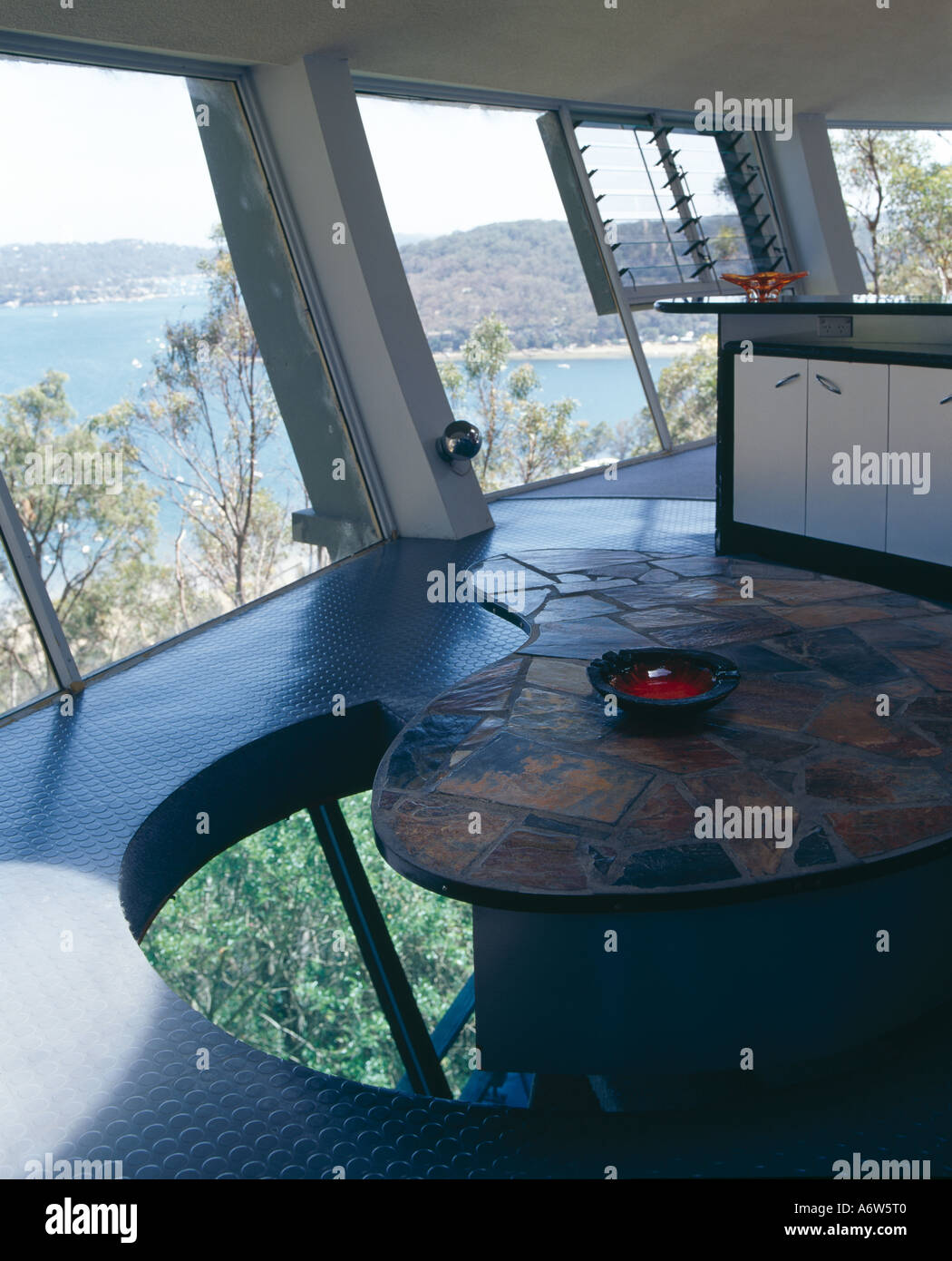 Spaceship House, near Sydney, New South Wales, 1963. Swivelling kidney shaped table that reveals the stairwell below. - Stock Image