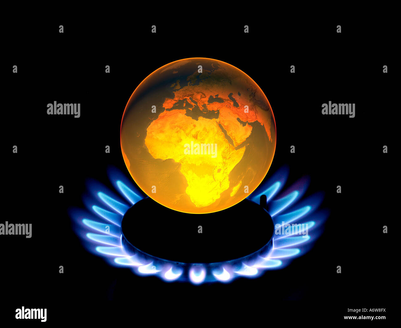 Earth globe with flames, symbol for global warming, climate change - Stock Image