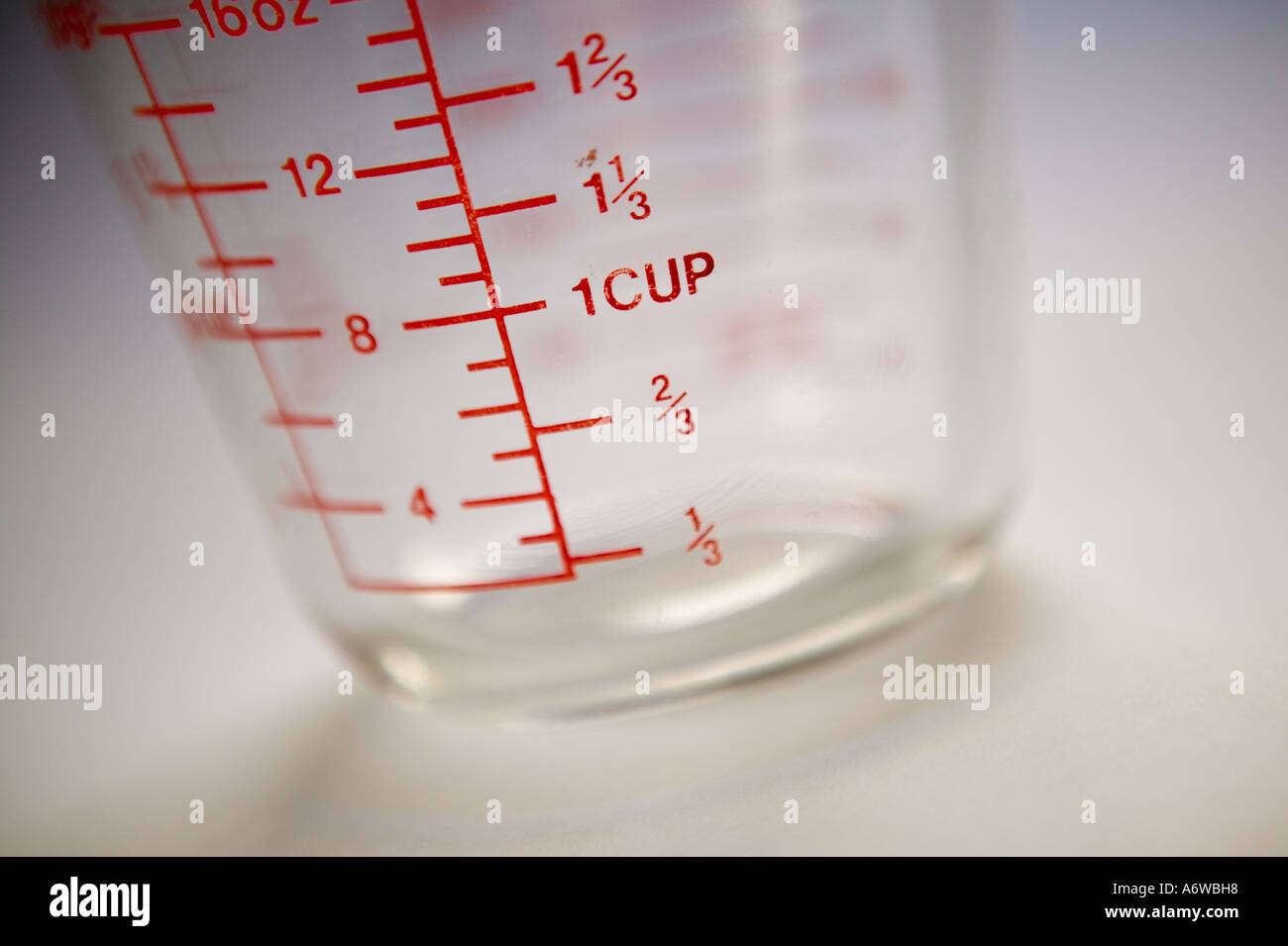 Studio shot of a measuring glass on a plain white background Stock Photo