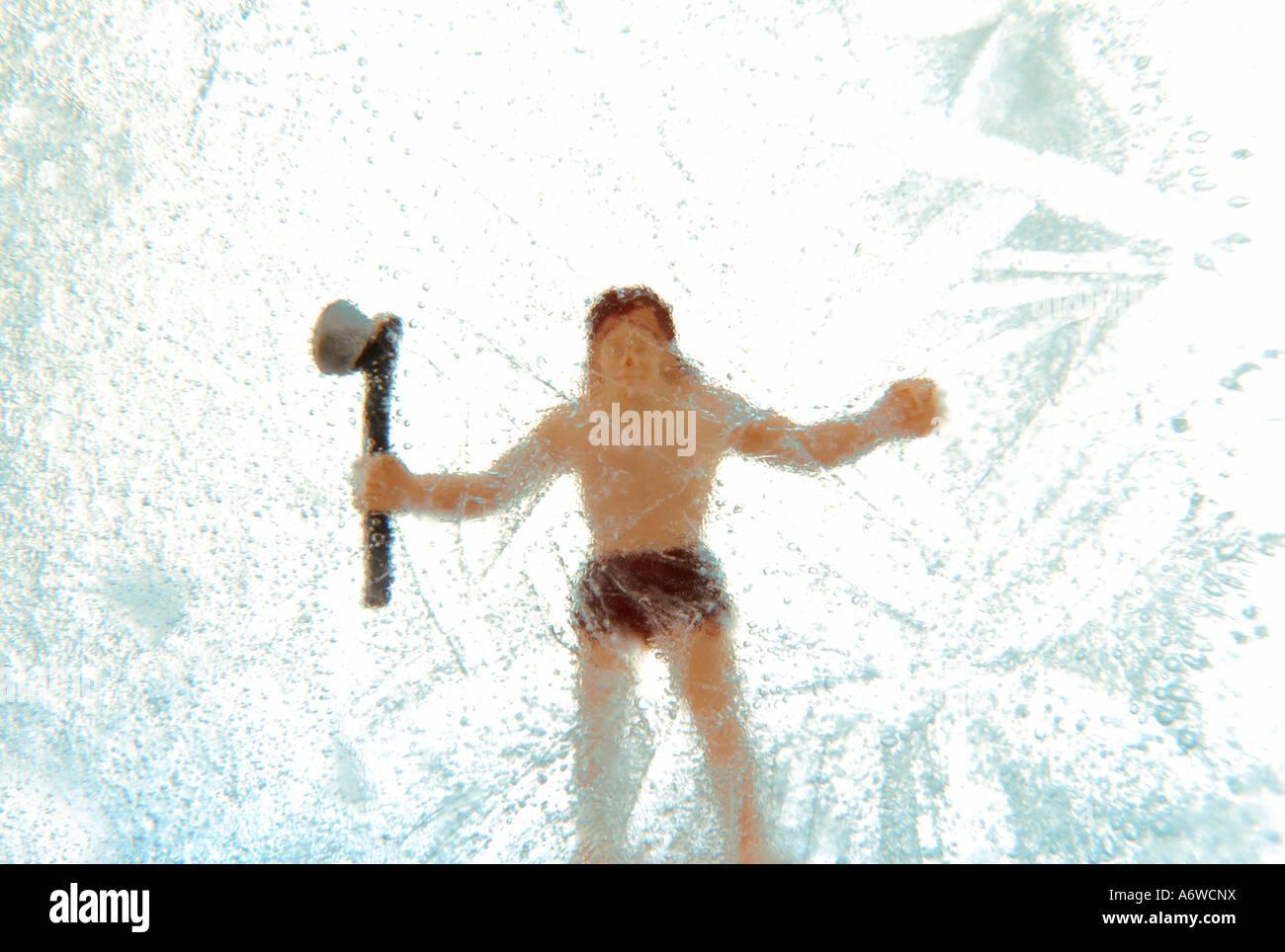 Frozen Toy Caveman - Stock Image