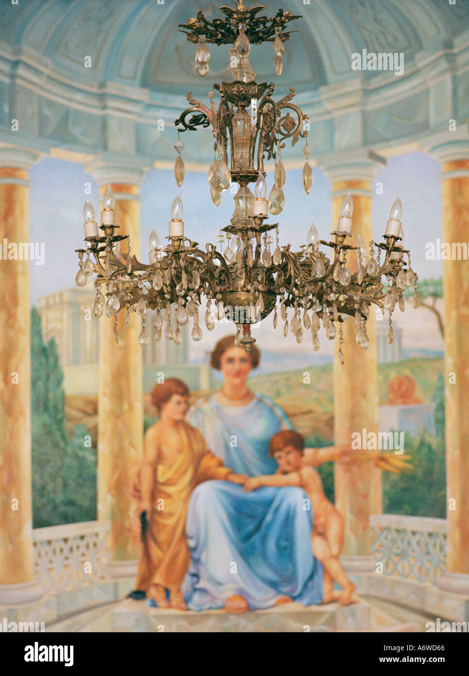 Chandelier and art painting in a house in Oaxaca City in Oaxaca State in Mexico in Latin Central America. Beauty Beautiful Serenity Travel - Stock Image