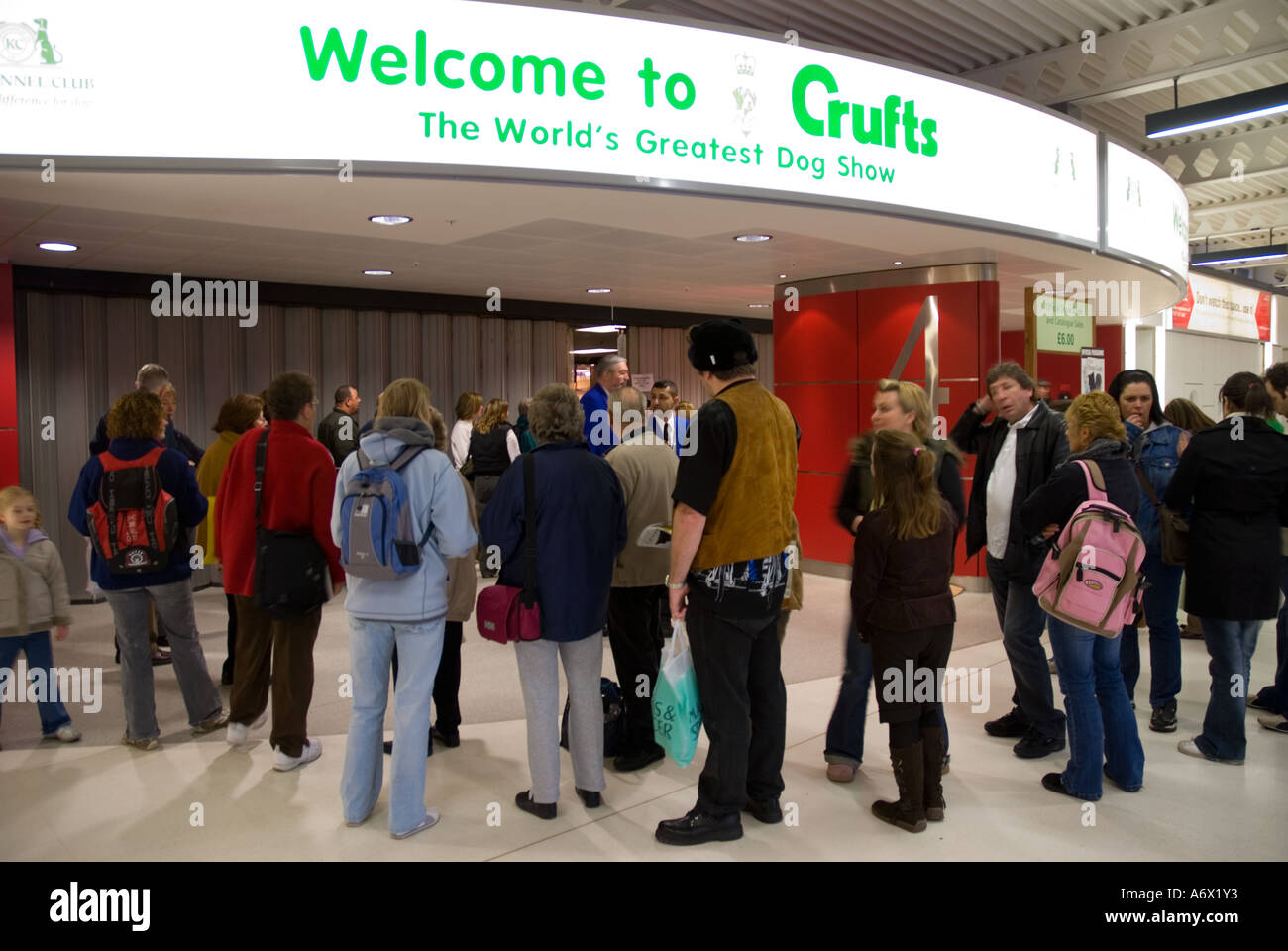 People queue outside Crufts before the doors open at the NEC - Stock Image