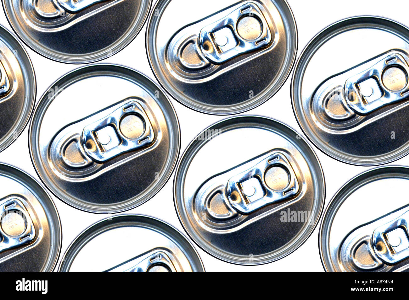 A group of Aluminum Cans tops and their pull tabs. - Stock Image