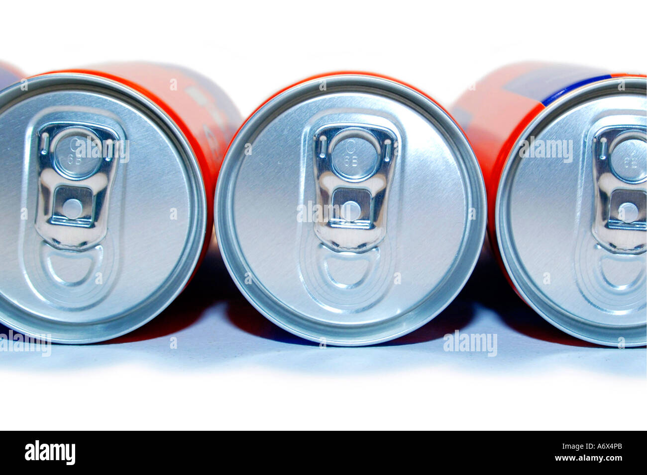 A group of Aluminum Cans and their pull tabs. - Stock Image
