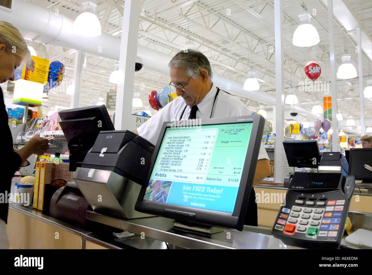 Adult Female Uses High Tech Computer Checkout System