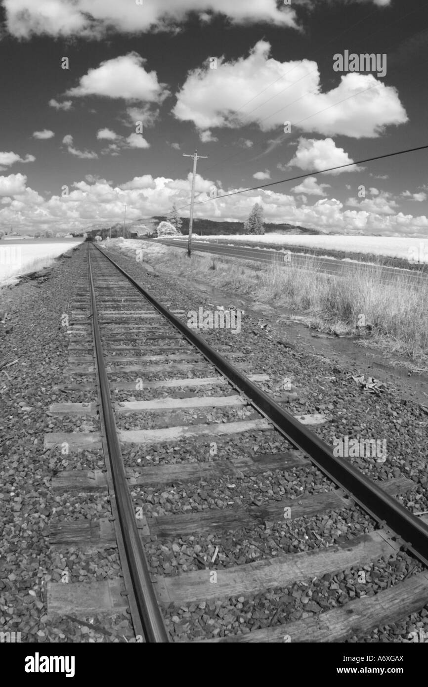 Infrared photo of train tracks and sky - Stock Image