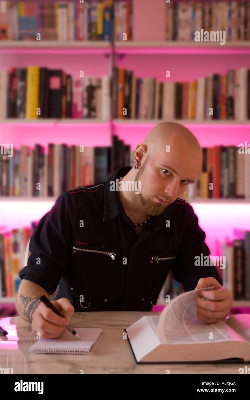 Punk boy studying - Stock Image