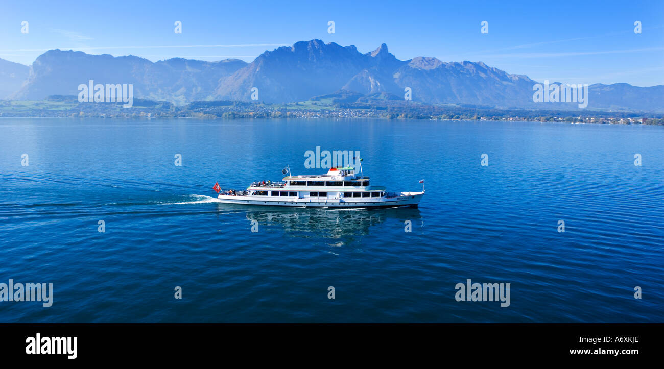 Switzerland Berner Oberland Tourist boat on Thunersee swiss alps behind - Stock Image