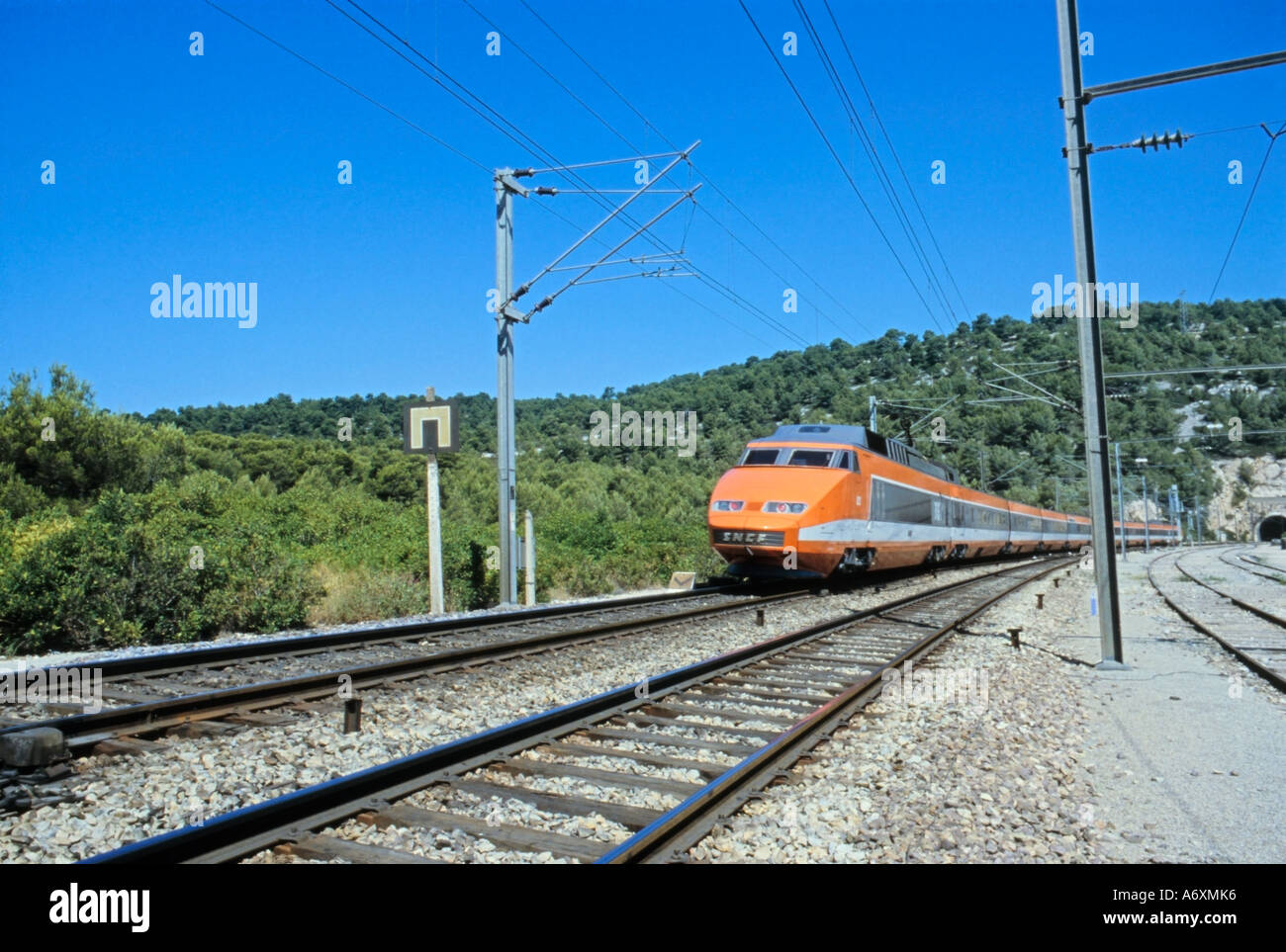 TGV French High Speed Train in the original Orange, Grey and White livery, passing Cassis South of France Stock Photo