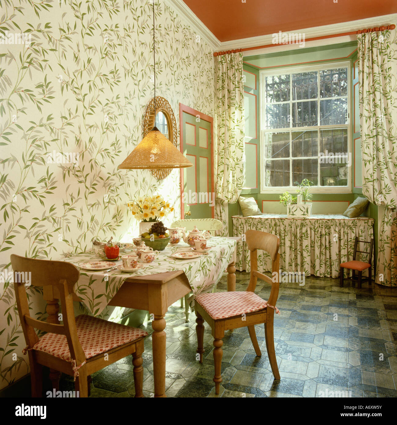 White And Green Floral Wallpaper And Matching Drapes In Small Dining Stock Photo Alamy