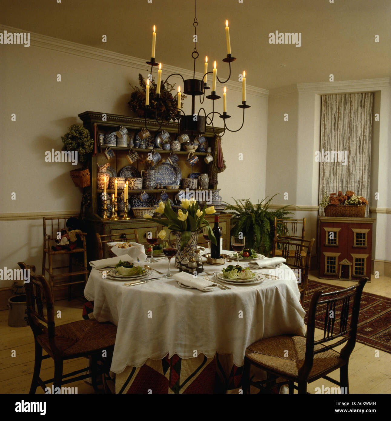 Pleasant Candle Chandelier Above Table Set For Lunch With White Cloth Beutiful Home Inspiration Xortanetmahrainfo