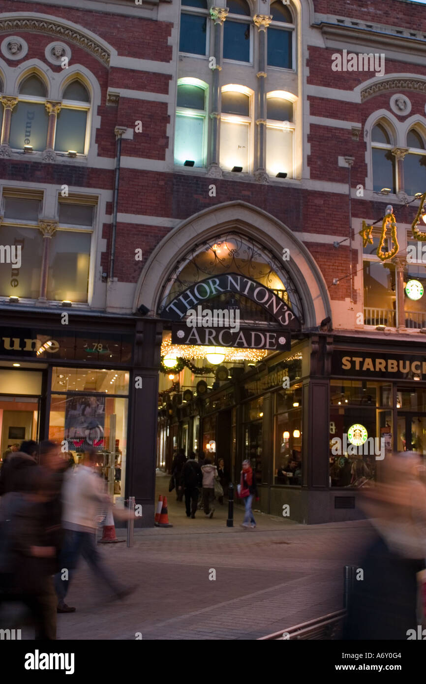 Evening view of entrance to Thorntons Arcade Briggate Leeds around Christmas - Stock Image