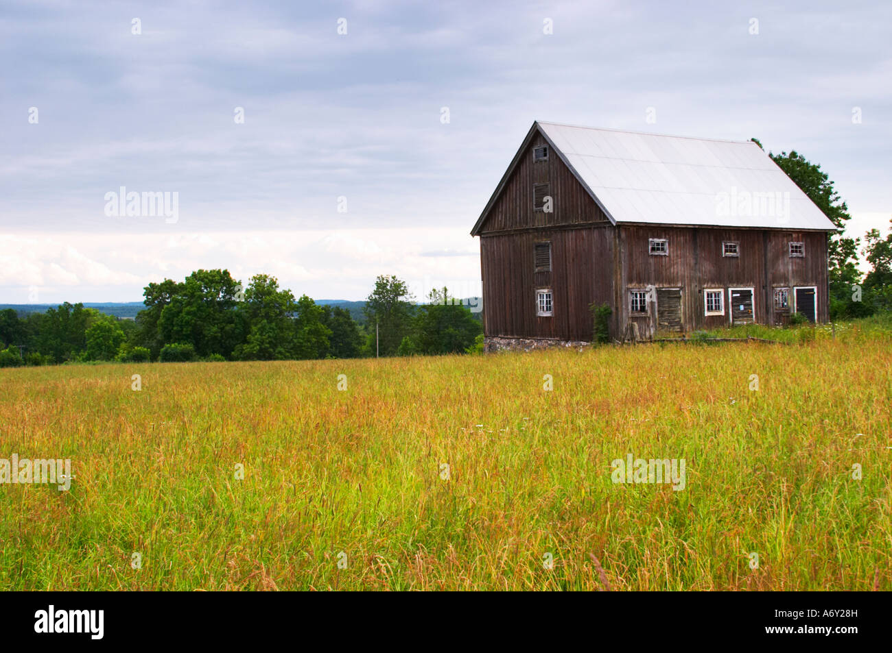 An old barn house on a field. Traditional style Swedish ...