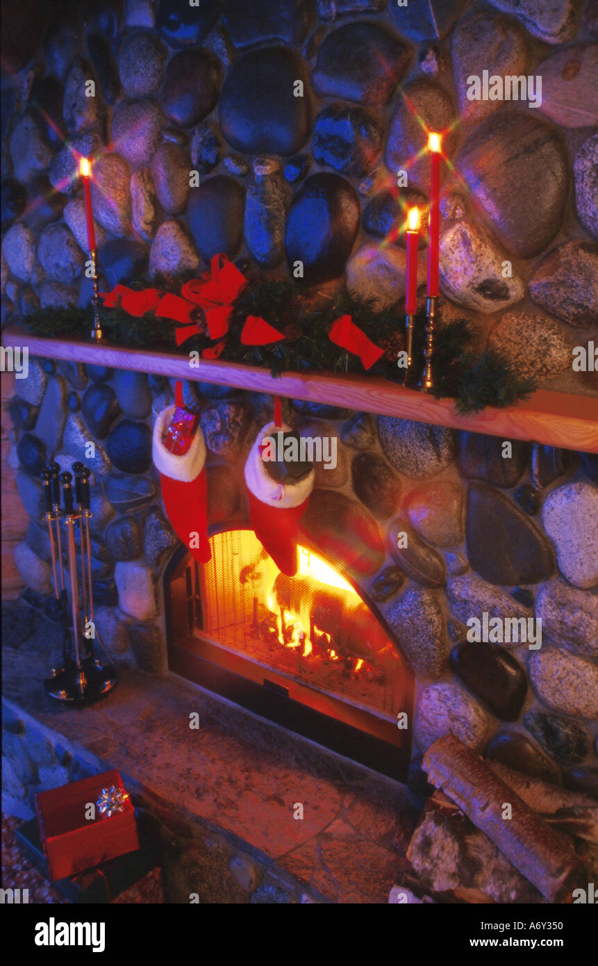 Fireplace decorated for Christmas Stockings Tree - Stock Image