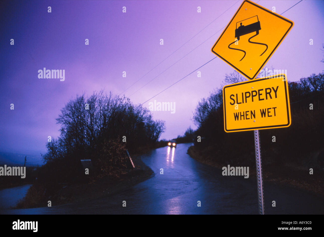Car Driving on Wet Road Slippery When Wet Sign SC AK Fall ...