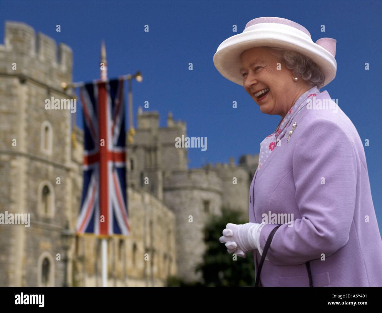 QUEEN ELIZABETH II Windsor Castle happy smiling HRH Queen Elizabeth 2nd in grounds of Windsor Castle Union Jack  flag in background England UK - Stock Image