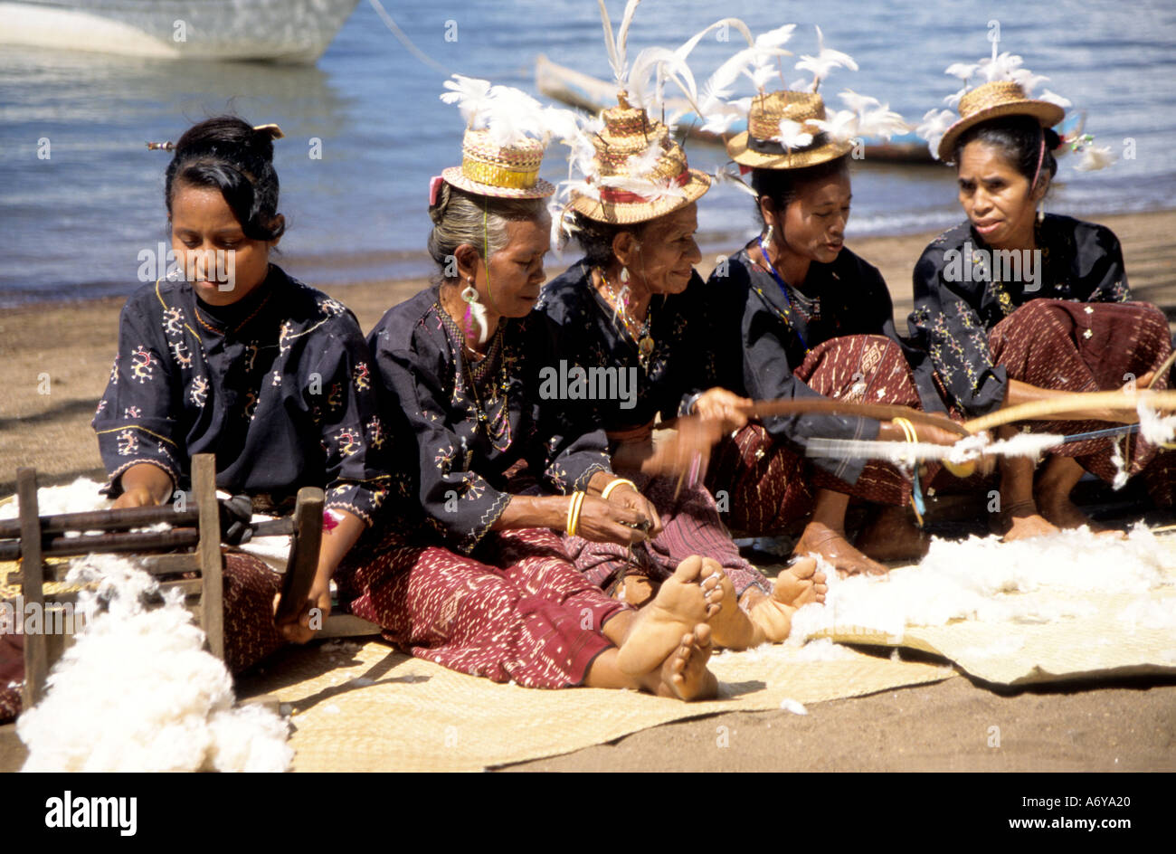 Group Of Tribal Women Sitting On A Beach On Flores Island Indonesia