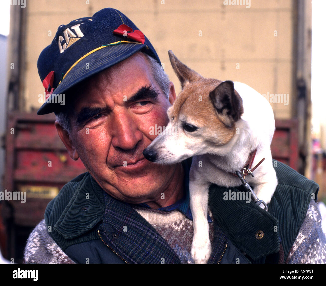 elderly man with little dog old love England Stock Photo