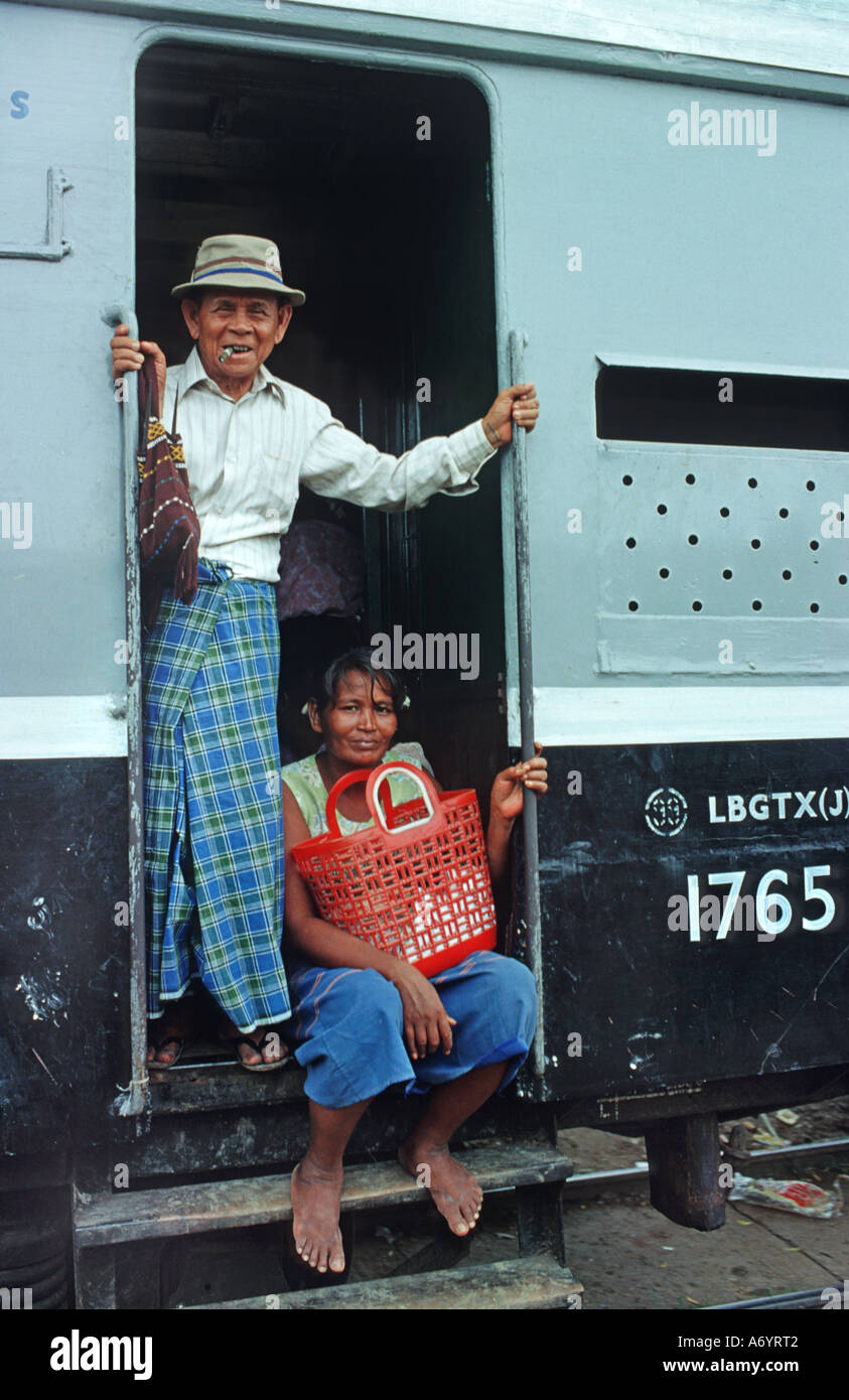 Man and woman in the door of a train Taungboyone nr Mandalay Burma - Stock Image