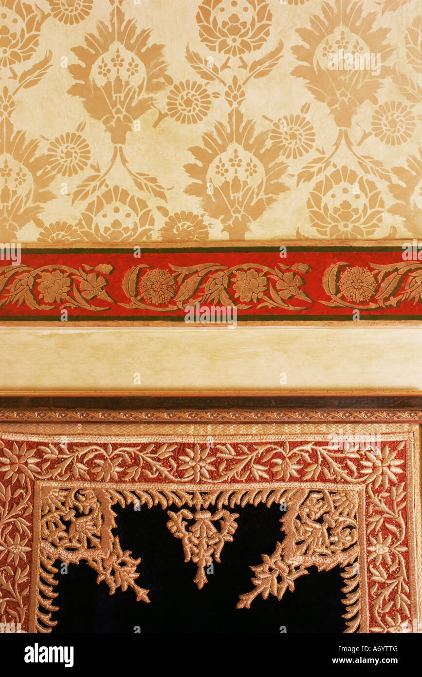 Example of traditional Zardozi gold embroidery work and stenciled wall decoration Lutyens style bungalow New Delhi - Stock Image