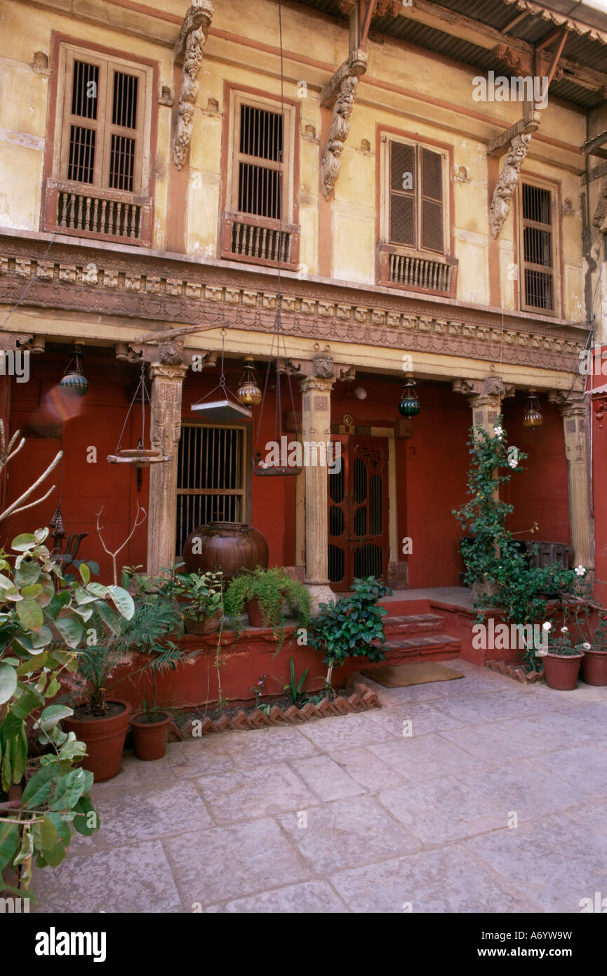 Restored traditional Pol house an all wood structure with wood carved facade some 300 to 400 years old Ahmedabad - Stock Image